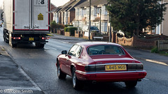 Jaguar XJS (M C Smith) Tags: pentax k3 jaguar xjs car red letters numbers symbols road traffic truck shadow chrome parking houses wall fence junction trees hedges sky blue pavement kerb van lights reflection tree lamp telegraphpole weeds green