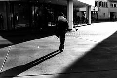 Walking on a path of light (Nikon F80) (stefankamert) Tags: light path film analog analogue blackandwhite blackwhite noir noiretblanc bw nikon f80 ilford hp5 voigtländer ultron people shadows highcontrast
