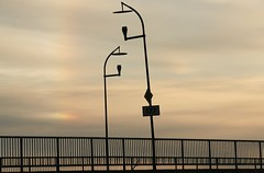 evening light (EllaH52) Tags: spring evening afternoon sunset clouds light sunlight bridge lines lampposts streetlights minimalism simplicity