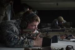 A U.S. Marine takes aim during sniper training with his MK40 Sniper Rifle. (#PACOM) Tags: recon sniper scoutsniper livefire spotter okinawa mk40 mk13 suppressor stressshoot gasmask msarines marine 3rdrecon 3rdmardiv 3dmardiv 3rdmarinedivision japan