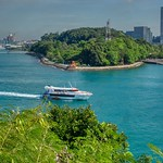 Labrador Nature Park with passing ferry seen from Siloso on Sentosa island, Singapore thumbnail