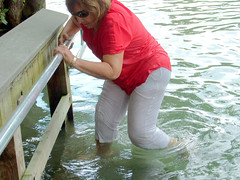 Stepping up (clarkfred33) Tags: river rainbowriver water wade step pants whitepants wetpants swimwear wetwoman wetlook adventure wetadventure dock wet