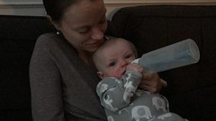 """Mommy Feeds Luc a Bottle • <a style=""""font-size:0.8em;"""" href=""""http://www.flickr.com/photos/109120354@N07/46735177775/"""" target=""""_blank"""">View on Flickr</a>"""