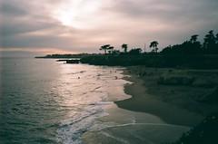 lit and unlit (peaceblaster9) Tags: ocean sea beach shore clouds sun santacruz california film konicac35 fujicolorc200 海 雲 ビーチ 海岸 フィルム フィルムカメラ フィルム写真 コニカ