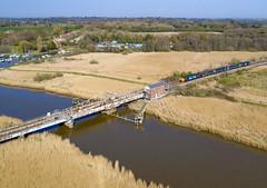 Approaching Somerleyton swing bridge (robmcrorie) Tags: 37423 37716 wherry line class 37 loco hauled norfolk norwich somerleyton swing bridge river waterway waveney phantom 4