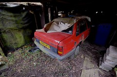 Nova 1.2 Luxe (Sam Tait) Tags: vauxhall nova luxe red 12 1200 4 door saloon 1991 retro rare classic car barn find stored spares repairs project garage urbex derp derelict abandoned house uk opel clean tidy shiny