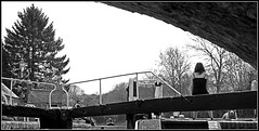 The Slow journey................. (Jason 87030) Tags: canal water cut crt trust canalside braunston gates people boat narrowboat slow speed women dog waiting compostion bw bbw black white mono tones frame border uk scene tunnel nelson england view trees naked bare branches trunk april bankholiday unitedkingdom distance pov perspective different tak experiment