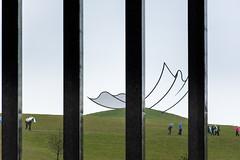 Illusions of size and closeness (Den Rob) Tags: sculpture sculpturefarm grass hills sky columns grid sizeillusion distanceillusion people nikon d7200 70300mm f4563 dx horizon