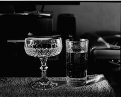 champagne or soda (philippnickerl) Tags: analogphotography analogfilm analogcamera foma stilllife stillshootfilm mamiyarb67 mamiyarb67pros istillshootfilm blackandwhite crystal champagne
