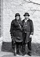 Steampunk Couple (sharon'soutlook) Tags: man woman male female steampunk steampunkempiresymposium steampunkfashion couple blackandwhite bw beard hats portrait fashion