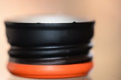 Cap (helensaarinen) Tags: macro blackorange bottlecap macromondays