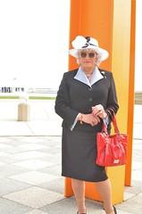 Orange or Black? (Laurette Victoria) Tags: milwaukee downtown woman laurette sunglasses purse suit silver easter hat