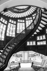 Spiral Staircase (Karen_Chappell) Tags: travel chicago usa illinois building architecture steps stairs staircase bw black blackandwhite interior curves curve railing windows wideangle fisheye canonef815mmf4lfisheyeusm rookery abstract geometry geometric