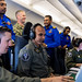 Shows a Sri Lanka AF airman how to operate a mission crew workstation aboard a P-8A Poseidon