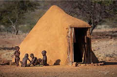 Namibia Kaokoland (FrancescaBullet) Tags: person outdoors human hut namibia paesaggio landscape people persone yellow giallo village children bambini home casa door africa