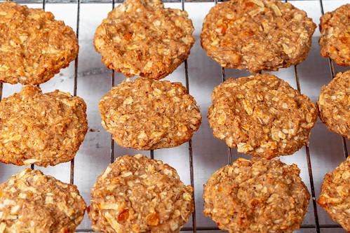 Fresh baked chip oatmeal cookies on metal rack