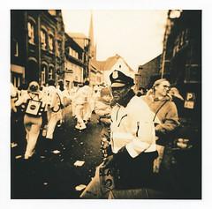 Karneval Cop (Uwe Kielas) Tags: analog film hp5 moerschefd holga fomatonemgclassic moerschse5 lith lithprint omegalith selentonung silbergelantine barytprint nrw karneval cop street