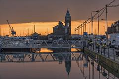 St Sampson's Harbour sunrise (Ningaloo.) Tags: reflection marina st sampson morning harbour clock tower