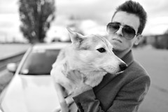 Evald and the Dog - 3 of 3 (Pavels Dunaicevs) Tags: irclv guy man male dog white monochrome portrait bokeh evening sunglasses street city town urban fashion model posing riga latvia nikon nikkor d750 28mm 18 autumn pet animal cute nice pretty young celebrity style lifestyle