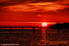 Red sunset (james c. (vancouver bc)) Tags: britishcolumbia colour color red ocean sea ripple wooden silhouette bridge sunset vancouver bc canada harbour harbor port sun sky water yellow orange travel nature mountains landscape park evening shadow outdoor cloud wave tide dock boat cloudscape mast pier northamerica reflect reflection white