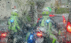 Rainy day (Lea Ruiz Donoso) Tags: rain lluvia raining water agua raindrop gotadeagua window bokeh blue azul light luz blur glass cristal green verde droplet chamberí madrid españa city ciudad car coche background fondo texture textura ripple outdoors airelibre weather clima moto vehicle motorcycle traffic transportation headlight art silhouette siluetas abstract silhouettes waterr lights luces puddle drip estálloviendo lloviendo itsraining