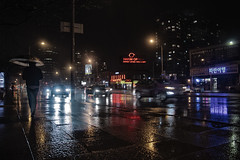Rainy Night (A Great Capture) Tags: north york rain rainy umbrella person traffic wet canon eos rebel t5i reflection agreatcapture agc wwwagreatcapturecom adjm ash2276 ashleylduffus ald mobilejay jamesmitchell toronto on ontario canada canadian photographer northamerica torontoexplore spring springtime printemps 2018 city downtown lights urban night dark nighttime colours colors colourful colorful light cityscape urbanscape digital dslr lens overcast cloudy water agua eau mirror glass reflections outdoor outdoors outside rainyday streetphotography streetscape photography streetphoto street calle darkness nocturnal illuminate lighting
