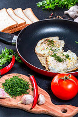 The concept of cooking Breakfast-fried chicken eggs in a frying pan with slices of bread, herbs and vegetables (wuestenigel) Tags: egg natural garlic pepper table chili background hot chicken delicious cook cooked meal traditional view eating closeup cooking breakfast healthy eggs food white ingredient bread pan top fried black green fresh fryingpan tomatoes kitchen