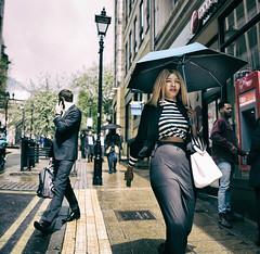 Finding Your Way Through (Bone Setter) Tags: streetphotography birmingham candid street lady umbrella shower rain sun sunny walking
