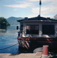 Suigetsu pleasure boat (Vinzent M) Tags: suigetsu 水月湖 mikata 三方五湖 fukui 福井県 lake japan zniv tlr rollei rolleiflex 35 zeiss planar 日本 kansai 関西 kdak ektar