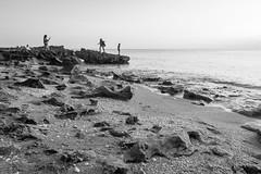 """On the Rocks"" (Sal Sciarrino) Tags: fineartphotography florida floridaphotographer blackandwhite wideangle surreal people seascape nikonusa nikond7100 teamtokina tokina1116"