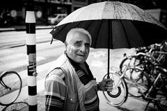 curiosity (Gerrit-Jan Visser) Tags: bewerkt streetphotography amsterdam umbrella rain curious pedestrian crossing