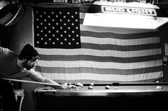 (SamBHart) Tags: 35mmfilm bwfilm newyorkcity newyork bw blackandwhite nikonfm2 35mmlens trix americanflag pool billiards usa brooklyn
