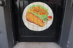 26th April 2019 (themostinept) Tags: 38greatrussellstreet camden bloomsbury london wc1 cafe munchkinsrestaurant plate fishandchips food painting sign door doorway restaurant circle green red