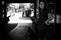 GR007872-Edit (alhawley) Tags: american bw kansascity usa blackandwhite candid highcontrast lowkey monochrome ricohgrii shadow street streetphotography woman smartphone