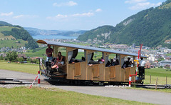 Stanserhorn Bahn, Switzerland - Car crosses the minor road at the top of the loop with Lake Lucerne in the distance on the 13th July 2018 (trained_4_life) Tags: stanserhornbahn switzerland stans funicular seilbahn funiculaire funicolare 缆车 kabel ケーブルカー