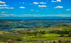 Looking Down At The Emmett Valley (http://fineartamerica.com/profiles/robert-bales.ht) Tags: forupload gemcounty haybales idaho landscape people photo places projects scenic states mountain emmett sweet storm squawbutte farm rollinghills idahophotography treasurevalley northamericanphotography clouds spring emmettvalley emmettphotography trees sceniclandscapephotography thebutte canonshooter beautiful sensational awesome magnificent peaceful surreal sublime magical spiritual inspiring inspirational wow robertbales town butte gem