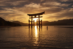 Itsukushima Floating Torii Silhouette - Miyajima Island (Japan) (Andrea Moscato) Tags: andreamoscato giappone japan asia japanese 日本 nihon nippon asian light luce shadow ombre prefecture attraction site national nature natura natural naturale landscape paesaggio day white sky cielo view vivid vista scenic parco park history historic ancient treasure wood art architecture monument brilliant water silhouette sea seascape seashore beach torii gate bay hiroshima unesco world heritage island seto inland setonaikai reflection tide sunset dusk orange red yellow people tourist evening sun dark wave aoi elitegalleryaoi bestcapturesaoi