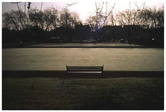 A Hazy Shade of Winter (Flat-Spin) Tags: olympus35rc newektachrome morning green dew bench lowlight quiet 35mm film grass slide glasgow kelvinway bowlinggreen winter trees