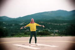Opa! (puppyhand) Tags: greece agios nikolaos aghios crete europe european holiday holidays island 2019 april yellow zip jumper hoody hoodie arms open outstretched out stretched helipad helicopter daios cove luxury resort hotel stand standing green tree trees pink hair