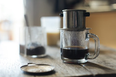 Vietnamese coffee brewing with metal filter (HungryHuy) Tags: vietnamesecuisine vietnameseculture vietnamese food vietnamesefood asian cuisine southeast coffee cafe ca phe sua da cafesuada iced condensed milk hot scooping du monde chicory drip filter phin nong caffeine