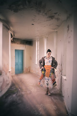 silence (John Mee) Tags: girl alone allaloneinthemiddleofnowhere corridor urbex blue orange door doorway house oldhouse dress thinking retro art solitude