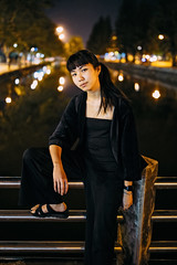 Araya V (KamrenB Photography) Tags: kamgtr kamrenb portrait portraiture night dark black clothes city lights evening asia asian thai thailand chiang mai chiangmai rail bridge reflection pose lean sit trees sky water moat ancient girl canon 6d 35mm 14 sigma art
