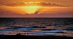 Sunrise At Cocoa Beach (Wes Iversen) Tags: atlanticocean cocoabeach florida nikkor24120mm beaches clouds motion oceans people silhouettes sunrises water waves