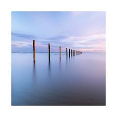 Calm down (Rob Schop) Tags: maasvlakte beach seascape 11 minimal pastel longexposure 10stopper nd1000 pola sunset sidelit zuidholland sonya6000 samyang12mmf20 f8 poles composition exposetotheright color lrcc