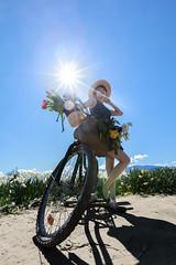 Tulip Season (Photo Alan) Tags: vancouver canada tulip sun sunshine bicycle woman flowers spring