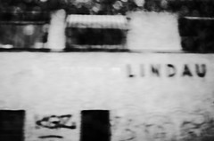 LINDAU (stefankamert) Tags: lindau street blur blurry noir blackandwhite blackwhite highcontrast mood mysterious ricohgr ricoh gr grii grain 28mm motionblur abstract