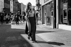 Thigh High (Silver Machine) Tags: oxford oxfordshire streetphotography street candid girl teddy phone sunglasses blonde walking shadows blackwhite bw mono monochrome fujifilm fujifilmxt10 fujinonxf35mmf2rwr