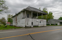 Kelly's Bar — Milledgeville, Ohio (Pythaglio) Tags: building structure historic commercial milledgeville ohio unitedstatesofamerica twostory balloonframe woodsiding porch altered abandoned vacant bar fayettecounty kellysbar