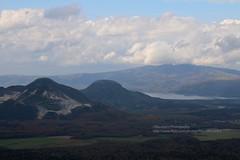 near Teshikaga, volcano landscape (blauepics) Tags: japan nippon island insel hokkaido north norden scenery landscape landschaft clouds wolken mountain berg valley tal teshikaga volcano vulkan lake see water wasser