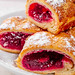 Close-up of sliced cherry roll with powdered sugar